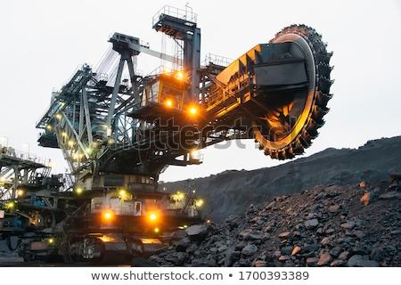 Secchio ruota escavatore costruzione rock lavoro Foto d'archivio © mady70