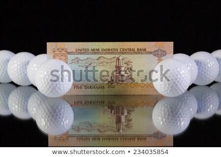 Money from Emirates on the black glass desk Stock photo © CaptureLight