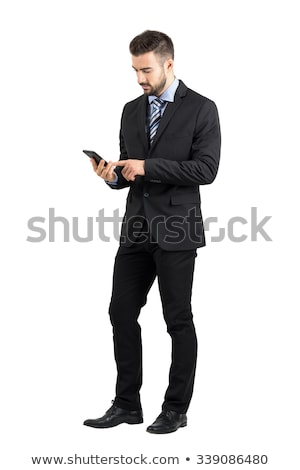 Full-length portrait of businessman using smartphone over white background Stock photo © deandrobot