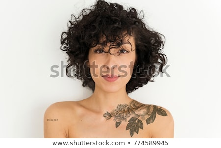 Tattoed woman with flowers. Stock photo © iofoto