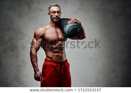 Férfi fitnessz modell visel piros rövidnadrág Stock fotó © stryjek
