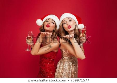 Dos feliz mujeres potable champán Foto stock © deandrobot