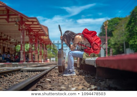 Young woman checking the time with a frown Stock photo © dash