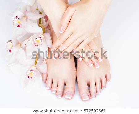 Woman hands and feet with french manicure Stock photo © svetography