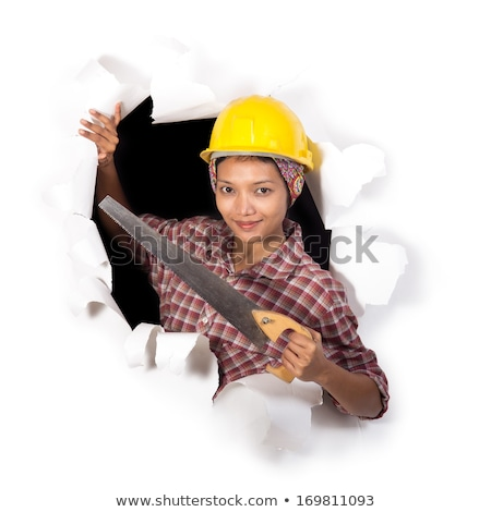 funny woman in helmet with a saw on a white background stock photo © vlad_star