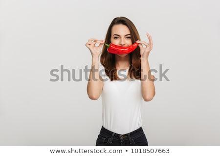 jóvenes · mujer · hermosa · pimienta · sonrisa · ojo - foto stock © konradbak