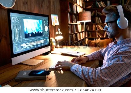 深刻 ビジネスマン ヘッドホン 作業 オフィス 遅い ストックフォト © deandrobot