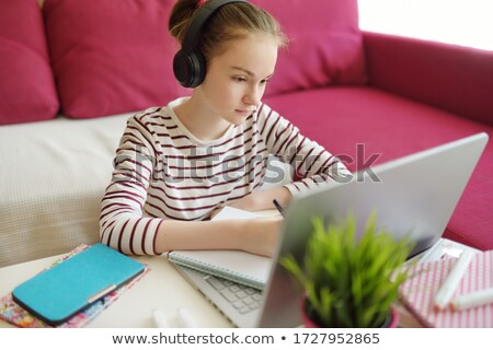 Foto stock: Schoolgirl Doing Her Homework