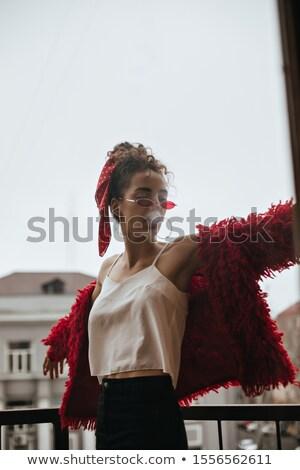 Bela mulher colorido topo varanda inclinando-se para trás brasão Foto stock © dash