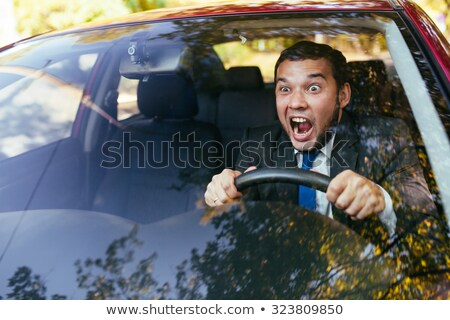 shocked scared funny looking young driver in the car.  Stock photo © ichiosea