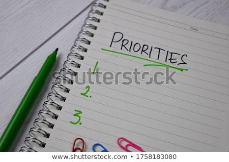 Priorities on wooden table Stock photo © fuzzbones0