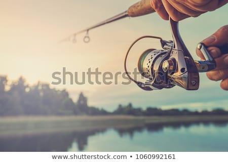 Gün batımı balık tutma iki adam dışarı geleneksel kano Stok fotoğraf © thisboy