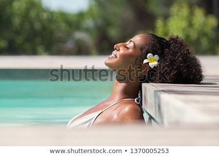 Lebarnult nő élvezi nap medence nyári vakáció Stock fotó © ozgur