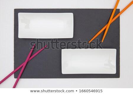 Narancs evőpálcikák üres szusi tányér pár Stock fotó © Digifoodstock