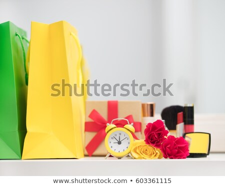 cute shopping bag make up set gifts alarm clock and roses on stock photo © massonforstock