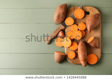 raw potatoes on cutting board stock photo © Digifoodstock