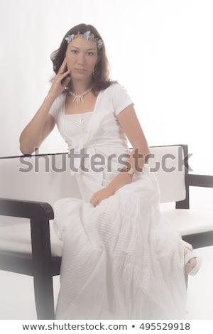 Belle fille séance président Photo stock © AntonRomanov