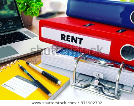 Rent on Red Ring Binder. Blurred, Toned Image. Stock photo © tashatuvango