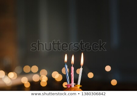 birthday chocolate muffin with three candles on black background stock photo © Sibstock