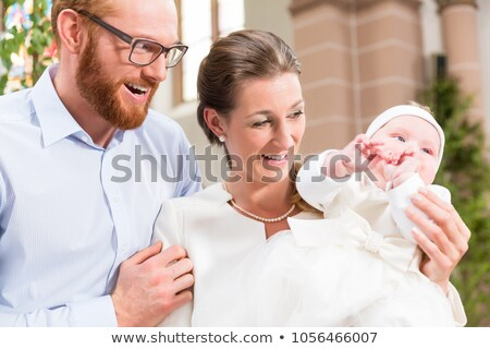 Family with baby at christening Stock photo © Kzenon
