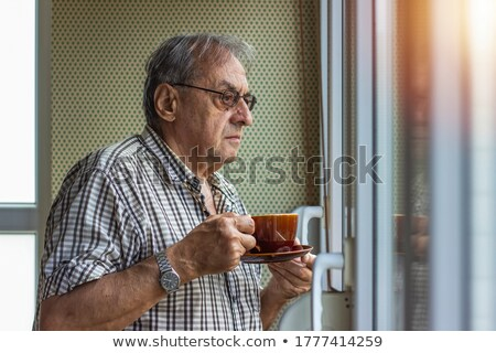 Portrait of mature man having a cup of coffee in balcony  Stock photo © wavebreak_media