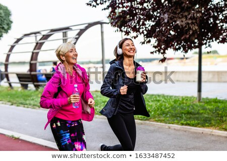 Two women outdoors smiling Stock photo © monkey_business