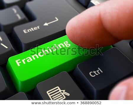 Green Franchising Button on Keyboard. 3D Illustration. Stock photo © tashatuvango