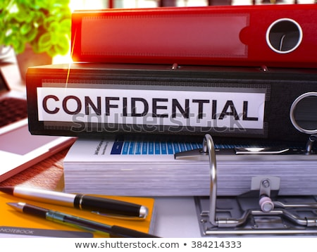 confidential data on red office folder toned image stock photo © tashatuvango