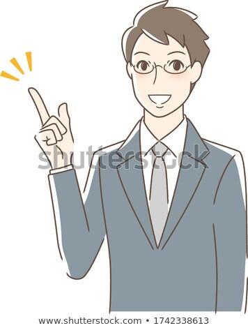 Asian businessman pointing with his forefinger Stock photo © RAStudio