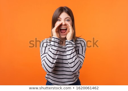 Portrait of a young angry woman standing and screaming Stock photo © deandrobot