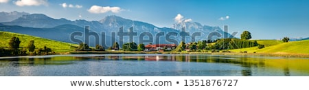 Panorama landscape of lake and village Stock photo © raywoo