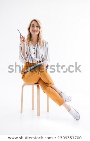молодые сидят стул белый девушки Сток-фото © feedough
