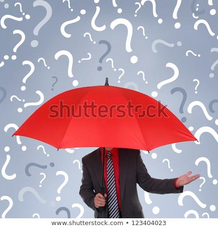 Man with red umbrella contemplates on rain Stock photo © stevanovicigor