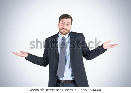 путать кавказский бизнесмен Плечи старший сомнительный Сток-фото © RAStudio