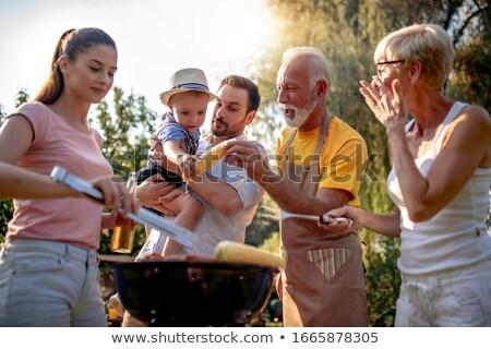 casal · sessão · grama · fruto · cesta · comida - foto stock © is2