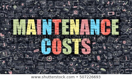 Maintenance Costs on Dark Brick Wall. Stock photo © tashatuvango