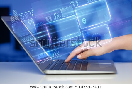 Cloud Application on Laptop in Modern Workplace Background. Stock photo © tashatuvango