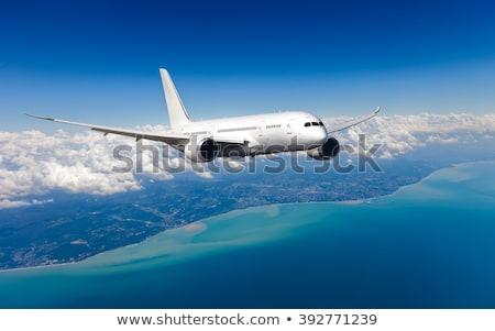 белый · самолет · Flying · небе · облака · посадка - Сток-фото © denbelitsky
