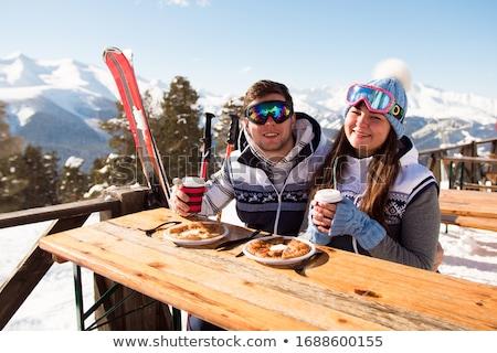 Stock photo: Caucasian white man drinking coffee at ski resort.