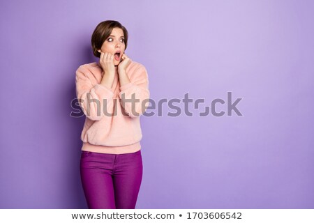 young woman in short pants looks worried Stock photo © feedough
