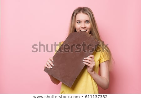 girl addicted to chocolate bars stock photo © is2