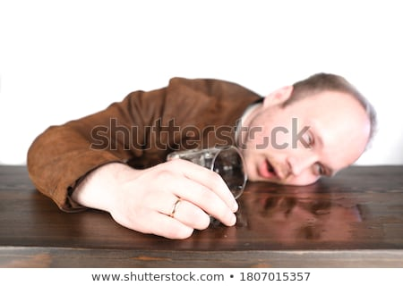 Man with whiskey glass lying on bar counter Stock photo © wavebreak_media