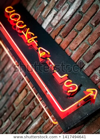 Nightlife neon sign mounted on brick wall Stock photo © stevanovicigor