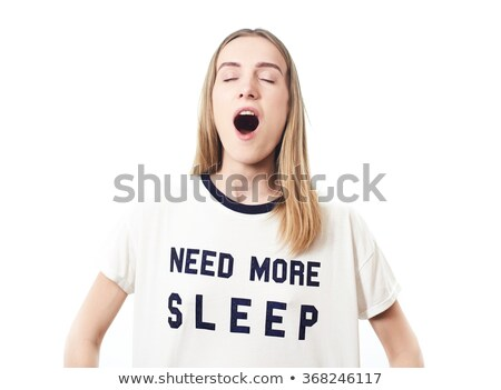Sleepy woman looking at alarm Stock photo © dash