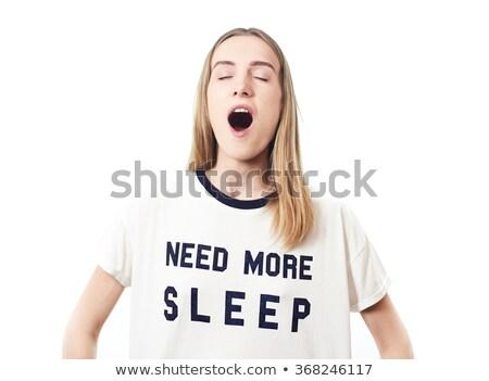 sleepy woman looking at alarm stock photo © dash