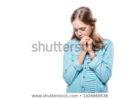 scared teenage girl in eyeglasses looking down isolated on white Stock photo © LightFieldStudios