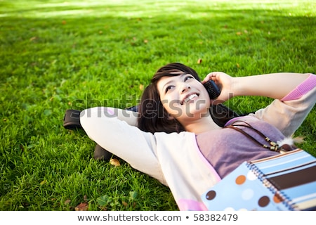 Girl lying down talking on mobile phone Stock photo © IS2