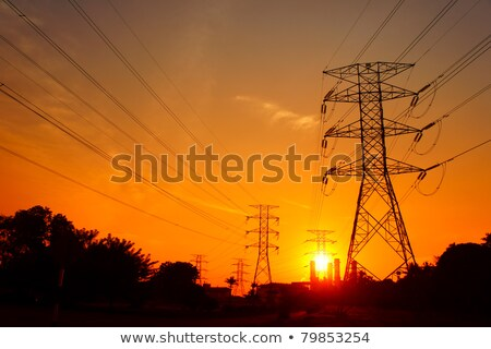 transmission towers at orange sunset Stock photo © martin33