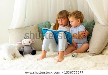 Fille jouer bébé frère magasin Photo stock © Kzenon