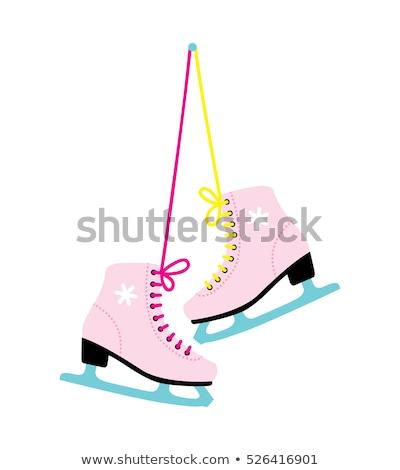 Pair of white classic ice skates on blue ice Stock photo © MarySan